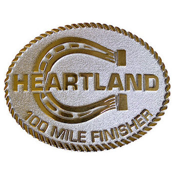 Ultra running belt buckle with horseshoe and white color fill background