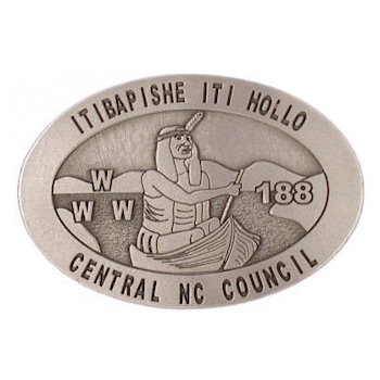 Oval belt buckle with Native Indian in canoe and hills in background
