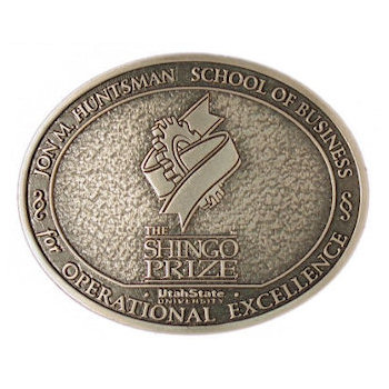 Oval Business school belt buckle with antique stippled background