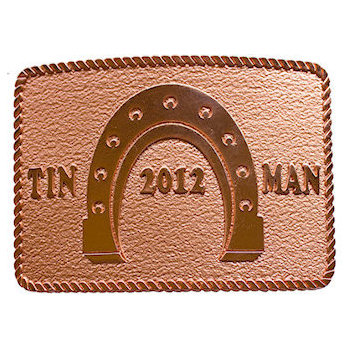 Classic western buckle for Tin Man 2012 with rope border and horseshoe in a copper finish