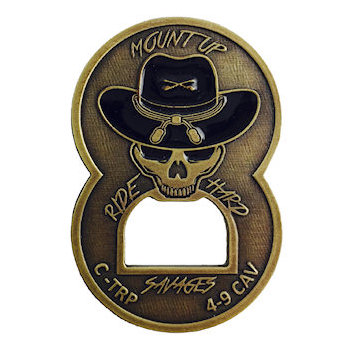 Coin with unique bottle opener incorporated into design of skull and hat